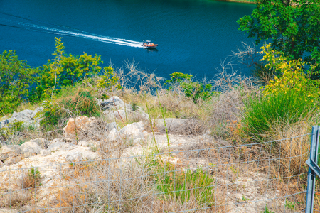 view of speed boat in blue water. seashore Фото со стока