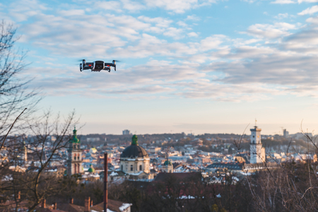 drone close up city on sunset on background. copy space Imagens