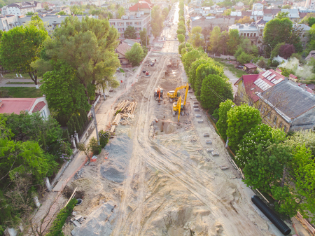 aerial view of construction site. street development. sunset