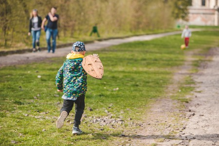 kids playing with ball and wooden shield. childhood time