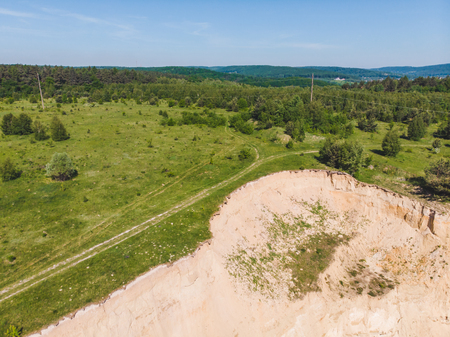 aerial view of sand connected with green field. landscape