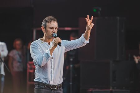 LVIV, UKRAINE - June 18, 2019: Vakarchuk at stage talking in microphone. political