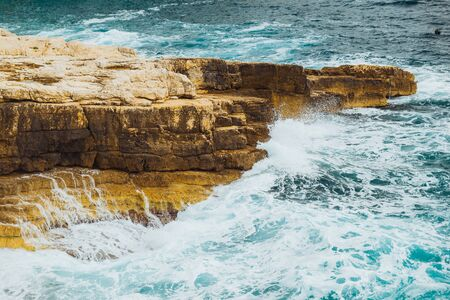 rocky beach with big cliffs stormy weather big waves wallpapers