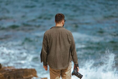 professional photographer shooting seascape. copy space