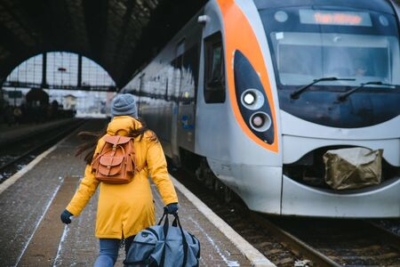 woman rush to get in time for train. travel by train