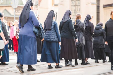 LVIV, UKRAINE - October 7, 2018: religious procession at city streets. nuns and monks