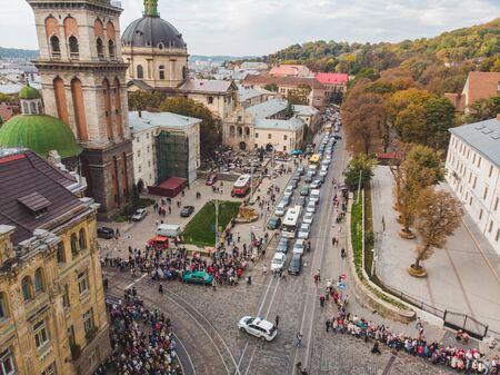 LVIV, UKRAINE - October 7, 2018: aerial view religious procession at city streets. nuns and monks Sajtókép