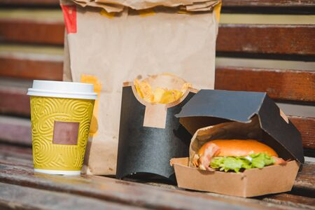 burger in box with fry potatoes coffee cup. fast food. street outdoors 写真素材