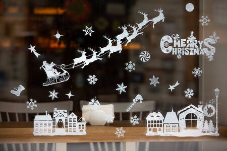 christmas holidays decoration on window glass winter time