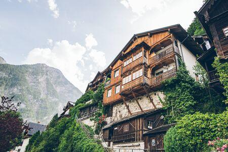 building at the cliff edge summer time hallstatt austria