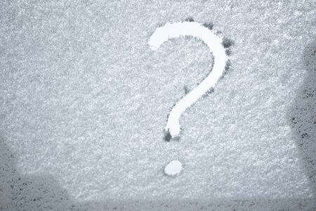 question symbol on snowed glass texture Zdjęcie Seryjne
