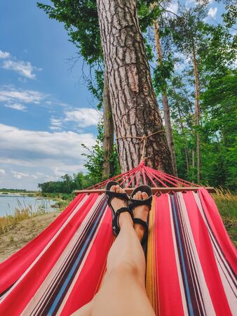 woman legs laying at hammock no face copy space Reklamní fotografie
