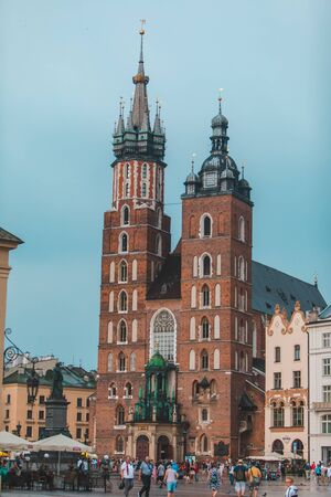 Krakow, Poland - June 16, 2019: market square with view of old mary church copy space 新聞圖片
