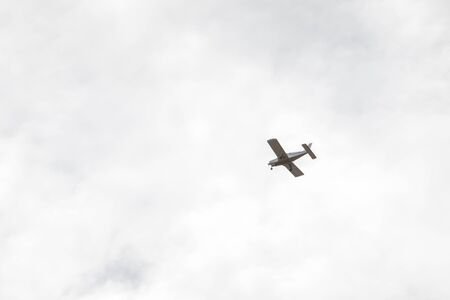 small airplane in sky copy space