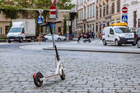 electric scooter at city street sharing urban transport concept