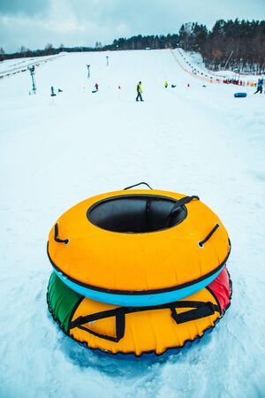 snow tubing rings close up. hill on background. winter family leisure