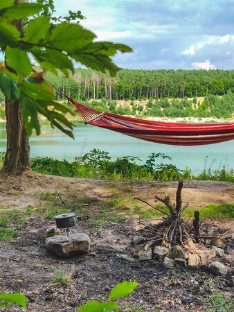 hammock between trees lake on background copy space