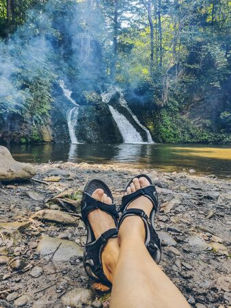 hiking concept woman laying with view at waterfall copy space 版權商用圖片
