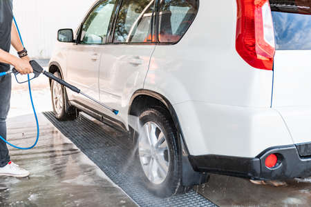 carwash concept. high pressure water cleaner