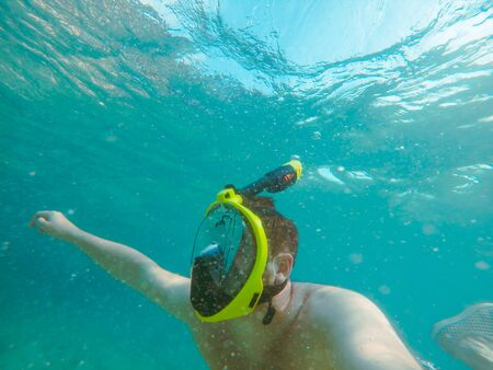 man with snorkeling mask underwater summer sea vacation clear transparent water