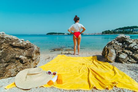 young pretty woman with at sea beach looking forward. copy space Reklamní fotografie