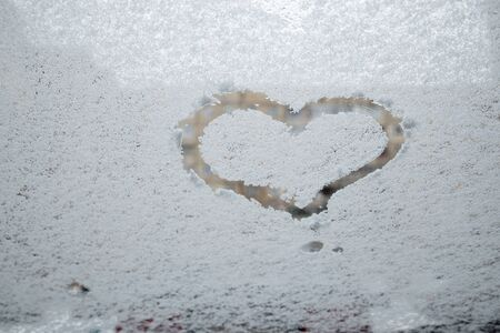 heart love symbol at frozen glass abstract