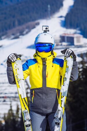 woman in ski equipment on the top of the hill. lifestyle