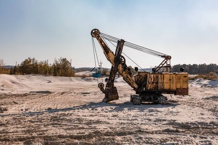 heavy industry old rusty excavator at sand quarry. copy space 스톡 콘텐츠