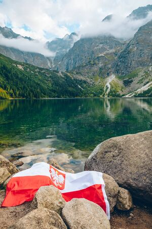 poland flag at the beach of mountains lake landscape scenic view