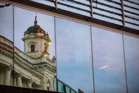 reflection of old building in glass window copy space