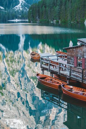 view of wooden dock boats station at braies lake in Italy. dolomites alpines 版權商用圖片