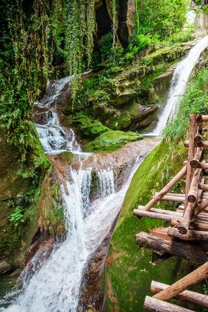 view of summer waterfall in green nature italy caglieron caves Foto de archivo