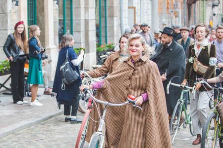 Lviv, Ukraine - May 4, 2019: city birthday festival people ride old retro bicycles. copy space