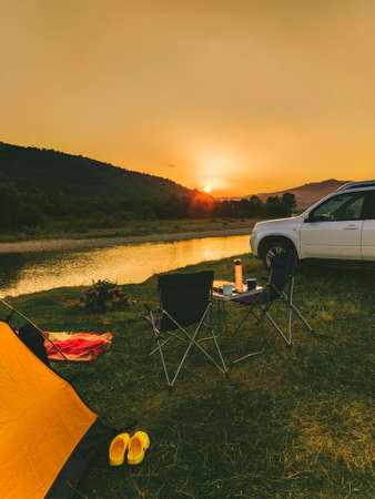 car travel concept camping place near mountains river copy space 스톡 콘텐츠 - 150716077