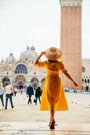 woman standing looking at saint marco piazza at sunny summer day bell tower saint marco basilica Stock fotó