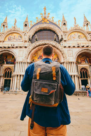 tourist man with backpack standing in front of saint marco basilica Venice, Italy. summer travel concept. copy space Stock fotó
