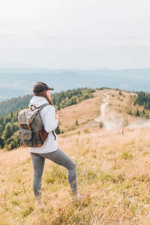 hiking concept woman with backpack at mountains peak autumn season