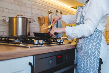 woman fry on pan kitchen view. copy space