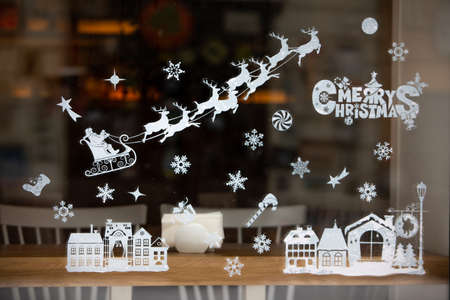 christmas holidays decoration on window glass winter time