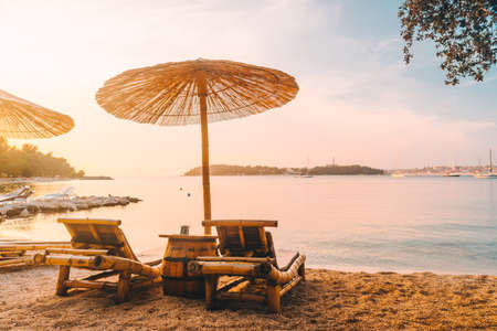 view of sea beach with sun loungers and umbrellas. copy space 스톡 콘텐츠