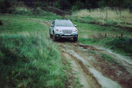 suv car travel concept by dirty road. copy space Reklamní fotografie