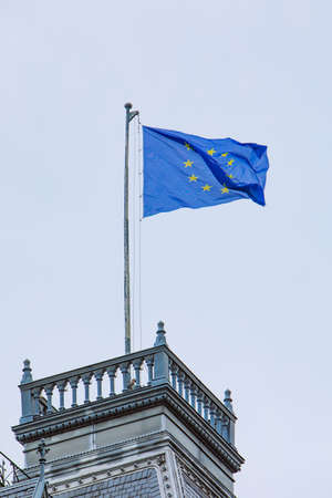 european union flag in front of blue sky