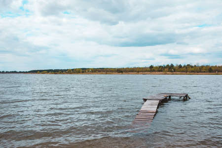 view of wooden old dock at lake beach