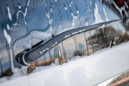 strong man washing car at self carwash outdoors