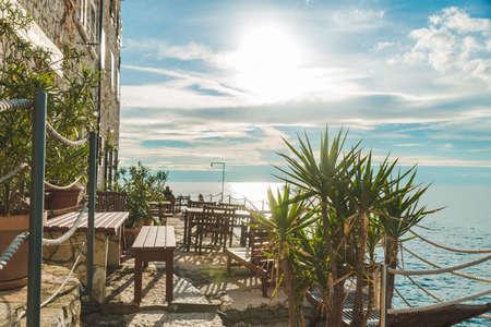 view of restaurant tables at sea beach. Rovinj, Croatia Banque d'images