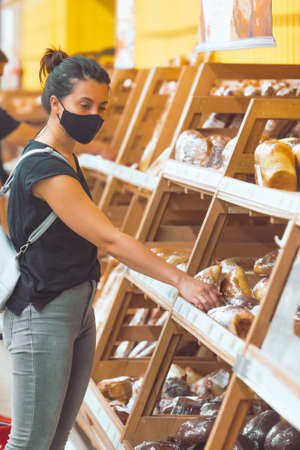 woman in medicine mask do groceries shopping