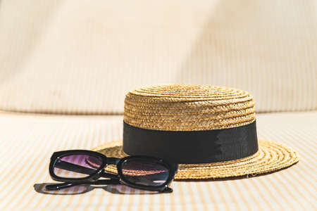 hat with sunglasses on sun lounger close up