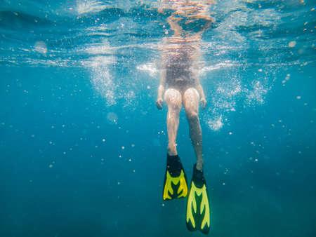 woman in flipper view underwater beach vacation summer season