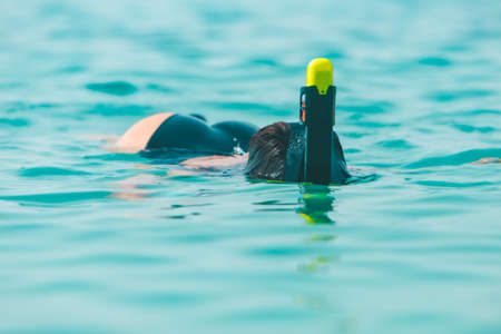 woman in snorkeling mask in sea water copy space Imagens