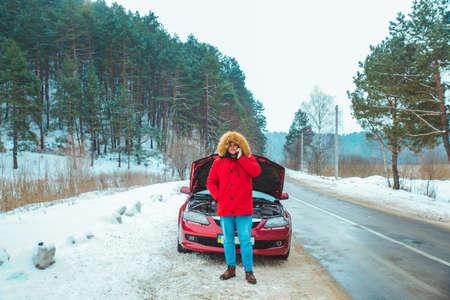 man standing near broken car at roadside snowed winter weather. copy space Stock Photo
